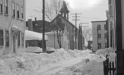 A view down Bentley Street in Salem after a heavy snowfall. The plow drift is probably about two feet high.