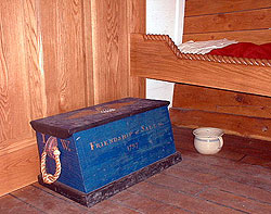 the captain's cabin is just big enough to hold a bed and the captains sea chest.