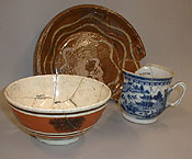 three dishes reassembled from fragments found in the archeological dig at the Narbonne House