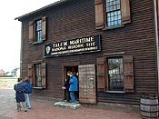 The Orientation Center at Salem Maritime is an old two-story warehouse. It is clapboarded, and has four windows in each side.