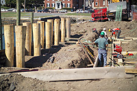 workmen placing footings for Pedrick Store House