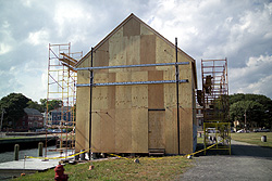 Pedrick store house covered with plywood