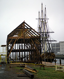 The frame of Pedrick Store House in place on the wharf