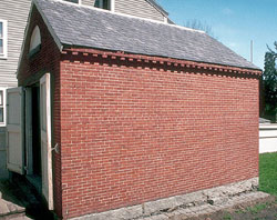The Scale House is a brick structure about the size of a two story garage