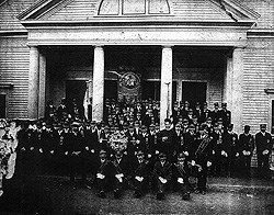 Members of the St. Joseph Society on the steps of the old wooden Polish Catholic Church.