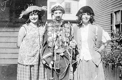 Three girls dressed in costumes