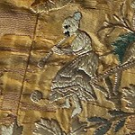 detail of embroidery showing a small figure