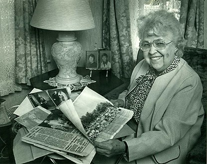 Portrait of a woman with photo albums
