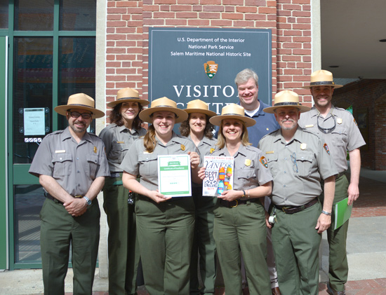 Staff Hold Award Certificate and Magazine Cover