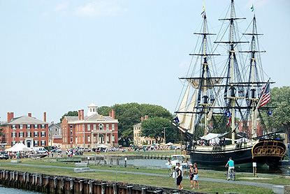 a view of the Salem Maritime Festival, with the tall ship Friendship in the foreground, and tents in the background