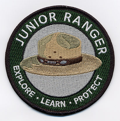a junior ranger patch, with the NPS hat on it.