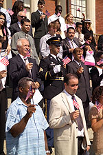 New citizens waving their flags, Sept 18, 2006.