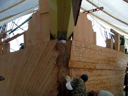 View of the bow of the ship showing new planking on the hull.