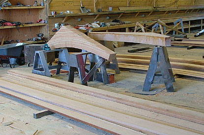 strips of wood are glued into an arc that will later be shaped like a shelf bracket to support the deck.