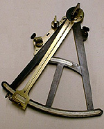 An ebony, ivory and brass sextant used for navigation.