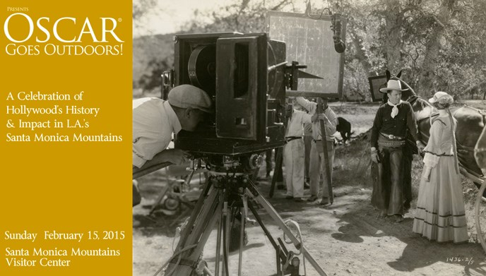 A black and white photo of a western movie being filmed
