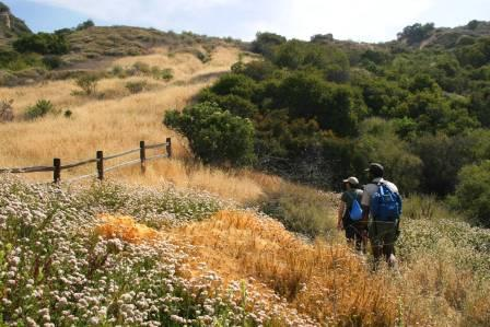 Two visitors enjoy the hiking the Backbone Trail through the Eastern end of the Santa Monica Mountains.
