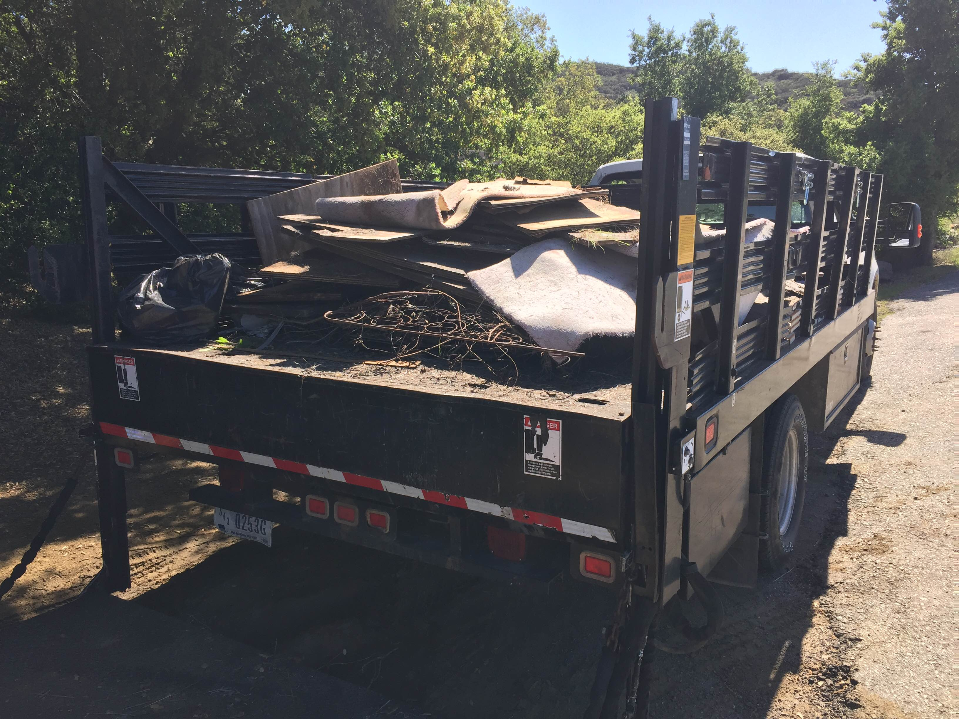Plywood boards, carpeting, and other trash piled in a truck after the clean-up. (Photo: National Park Service)