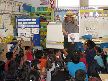 A teacher-ranger-teacher shares with her class the meaning behind the National Park Service arrowhead.