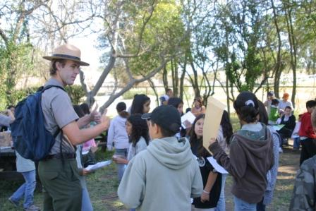 A ranger gives students a thumbs up as they share with him all the cool things they learned in the park.