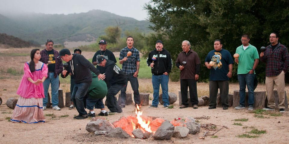 Chumash singers enjoying traditional song and dance by campfire at Rancho Sierra Vista