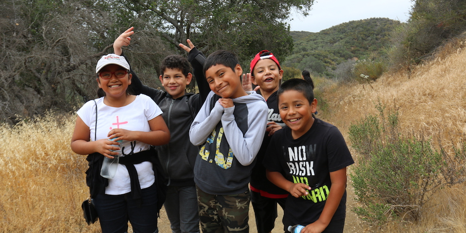 Students pose for a picture while on a hike