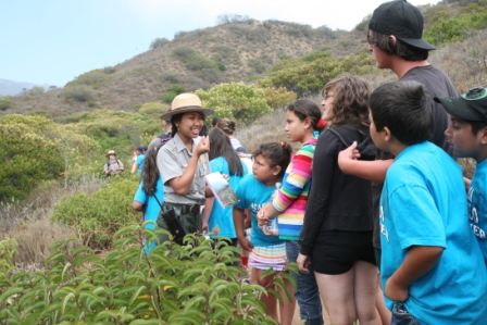 A ranger talks to students visiting the mountains about the flora of Leo Carrillo State Park.