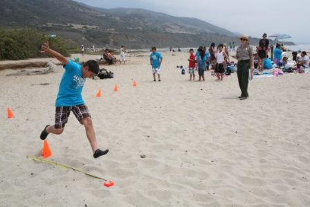 Students race to finish an obstacle course at Leo Carrillo State Beach as part of a ranger-led fitness program.