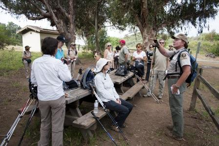 BBT hikers listen to a park volunteer talk about Trippet Ranch.