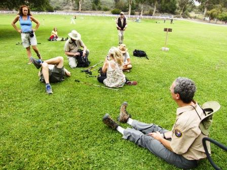 BBT hikers relax on the lawn at Will Rodgers State Historic Park.