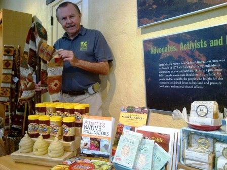 Volunteer John Millraney displays items for sale in the visitor center store.
