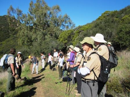 Hikers pause to discuss the complexities of the Santa Monica Mountains