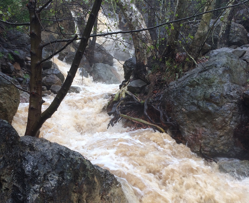 The creek in Solstice Canyon rushes with water after a heavy winter storm