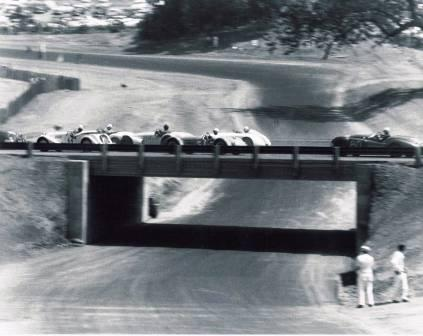 "Race cars travel over the ""bridge"" at Paramount Ranch racetrack in the mid 1950's."
