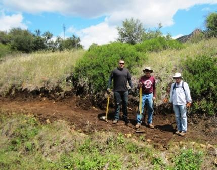 Santa Monica Mountain Trails Council volunteers take a break from working on the trail to pose for a picture.