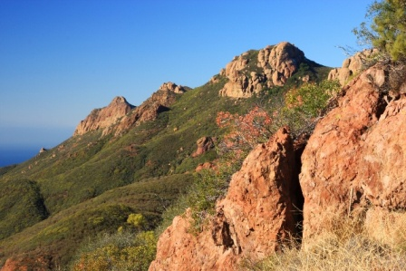 Hikers can view the colorful cliffs that make up Circle X Ranch from the Backbone Trail.