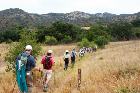 Hikers cross Eagle Junction on the Backbone Trail.
