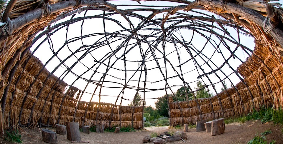 Looking up from within a traditional Chumash wood structure