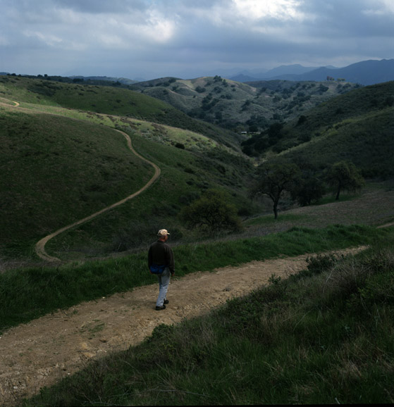 A hiker takes a stroll along one of the many winding trails that make-up the Chesseboro Canyon landscape.