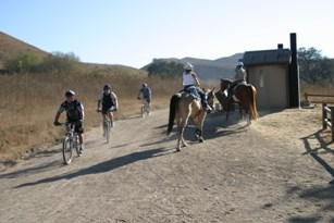 Equestrians and Bicyclists yield to one another on a trail in Cheeseboro.