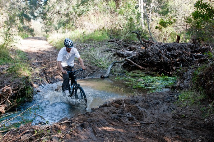 Mountain biker splashing through a puddle