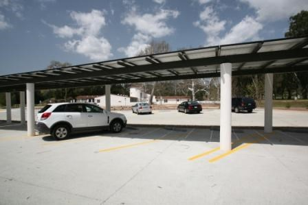 Solar panels in the parking lot help keep cars cool.