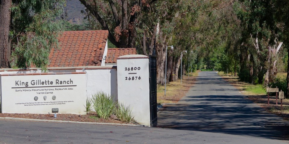 The street leading to the visitor center is to the right of the King Gillette Ranch sign