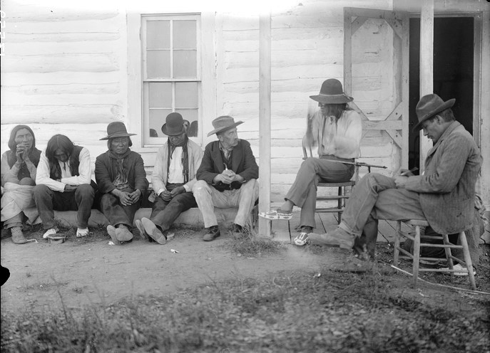 Author, naturalist and historian George Bird Grinnell, 3rd from right, collecting old stories from Cheyenne Indians.  Circa 1908