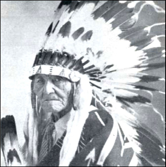 Stacy Riggs circa 1937 in traditional clothing and head dress.