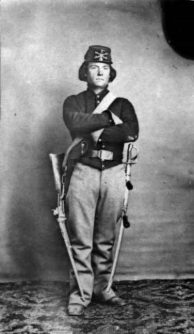 Private Joseph Aldrich of the First Colorado Cavalry died at the Sand Creek Massacre. He is seen here in uniform with carbine and saber.
