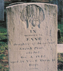 This gravestone contains images of the classical revival of the early 1880s.
