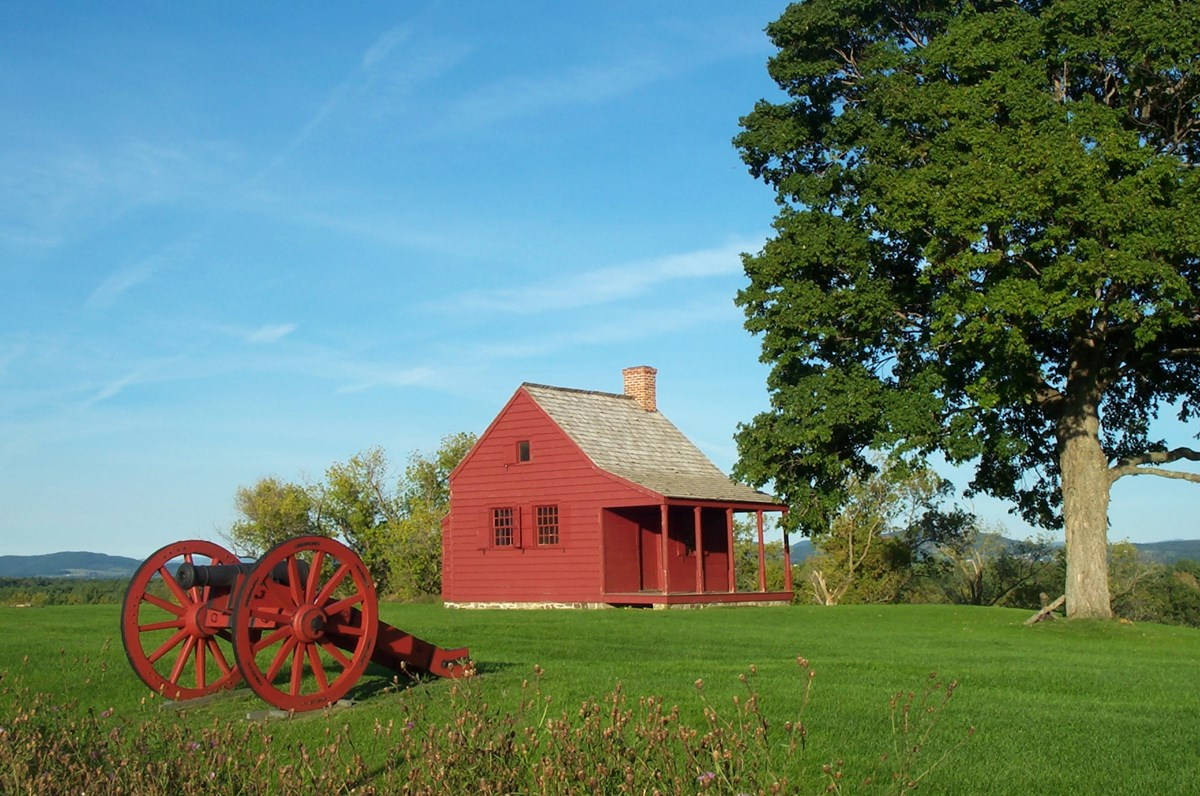 Small, red, one-room farmhouse