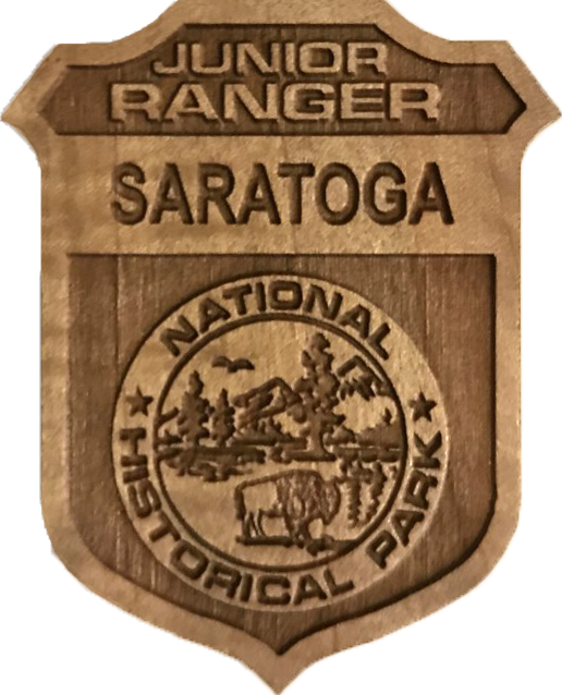 wooden junior ranger badge with saratoga in the top banner