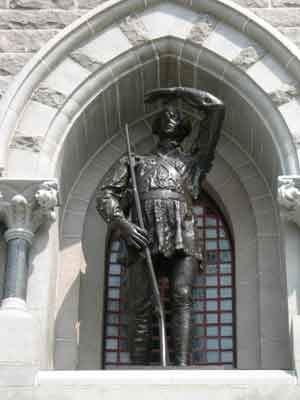 Bronze statue of American Colonel Daniel Morgan.  He raises his left hand to shield his eyes in the afternoon sun.